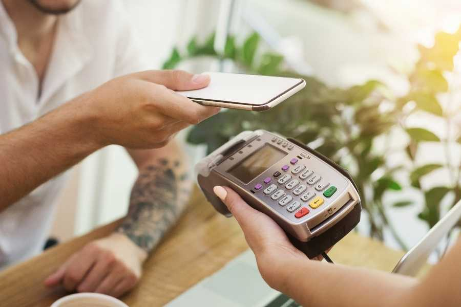 person paying with card