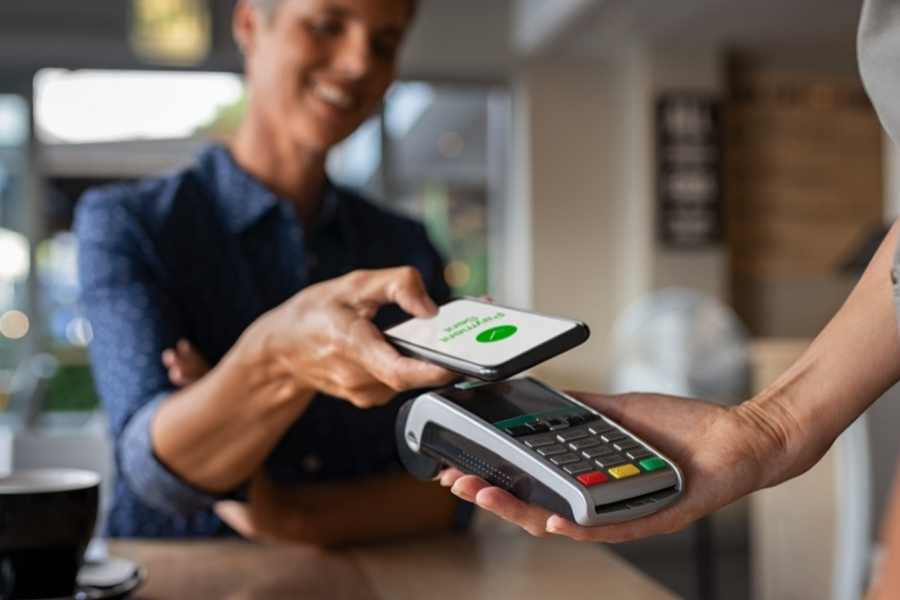 person paying with phone